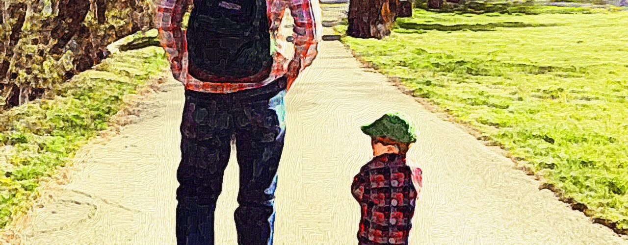 My son and I walking through the park.